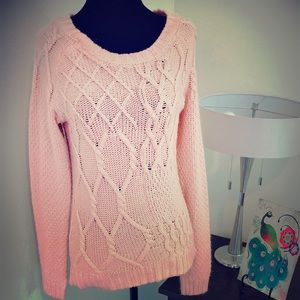 Pink cable knit sweater.